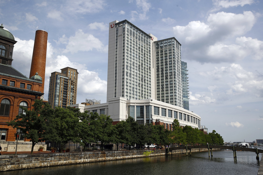 Among U.S. structures that appear to have been built with cladding made by the Arconic company include the Baltimore Marriott Waterfront hotel, above, which towers more than 30 stories over the city's harbor, the Cleveland Browns' football stadium, and a school in Alaska, according to Arconic brochures. British authorities are examining whether the panels helped spread the fire that ripped across the Grenfell Tower's outer walls June 14, killing at least 80 people.