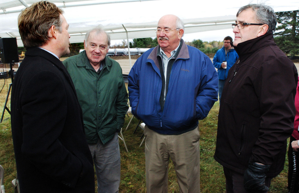 Attorney Dan Walker of Preti Flaherty, from left, speaks with Elery Keene and Ken Fletcher, both of Winslow, and Gary Bowman of Oakland before a groundbreaking ceremony for the Fiberight facility in Hampden on Oct. 26.