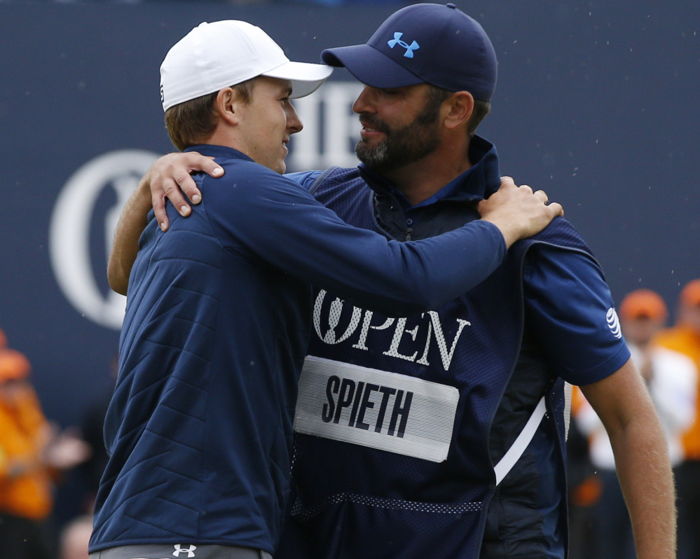 Jordan Spieth celebrates with his caddie Michael Greller after winning the British Open on Sunday. Spieth will go for the career grand slam at the PGA Championship in August.