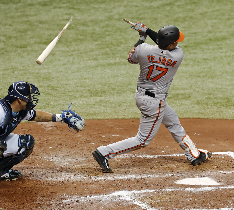 Ruben Tejada of the Orioles breaks his bat on a swing Monday night in St. Petersburg, Fla. Rays catcher Wilson Ramos was injured by the bat barrel on the play and left the game.