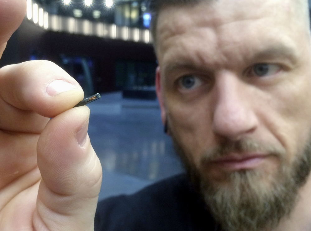 Jowan Osterlund of Biohax Sweden holds a microchip implant similar to ones given to workers there earlier this year. Three Square Market in River Falls, Wis., is partnering with Biohax International in offering to microchip Three Square workers.