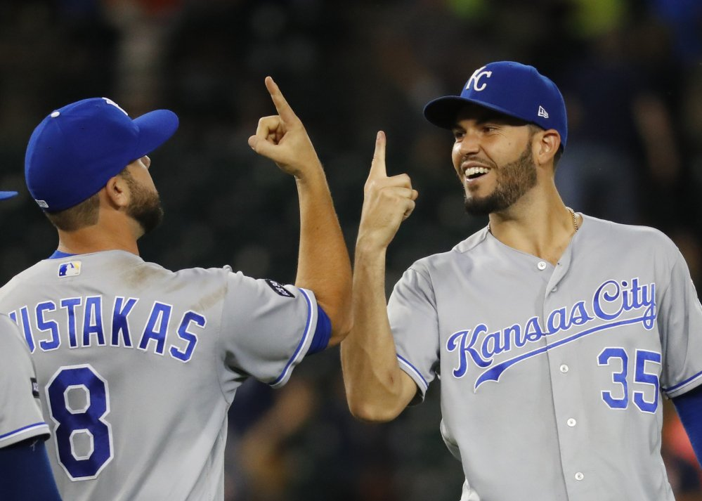 Kansas City's Mike Moustakas and Eric Hosmer celebrate after a 3-1 win Tuesday night in Detroit. The Royals extended their winning streak to seven.
