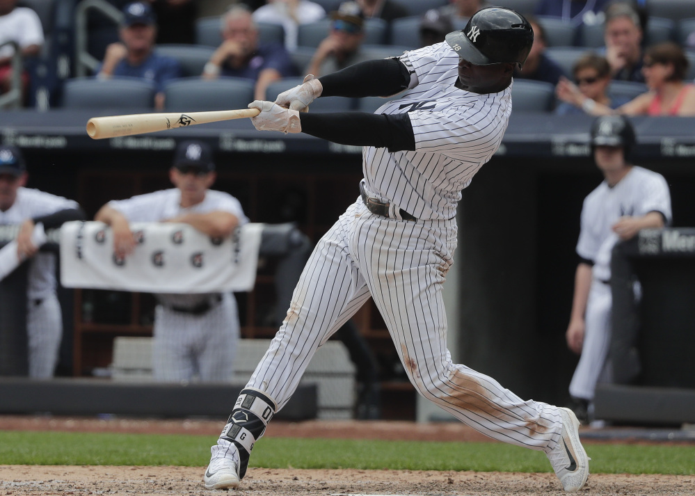 Didi Gregorius connects for a two-run homer against the Cincinnati Reds during the seventh inning of the Yankees' 9-5 victory in New York on Wednesday.