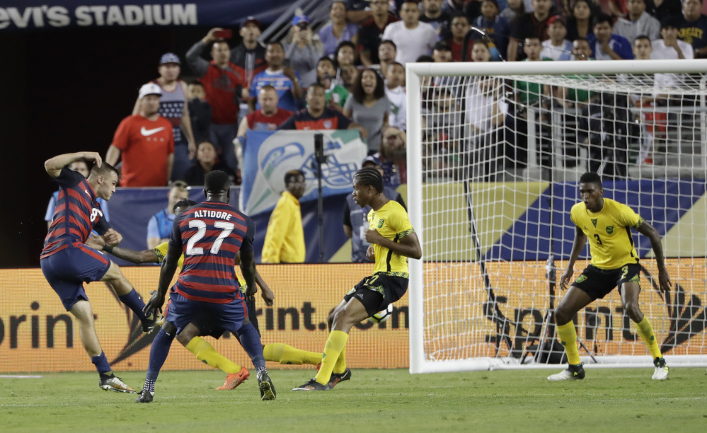 Jordan Morris of the United States scores his team's second goal against Jamaica during the second half of a 2-1 victory in the Gold Cup championship match late Wednesday night in Santa Clara, Calif.