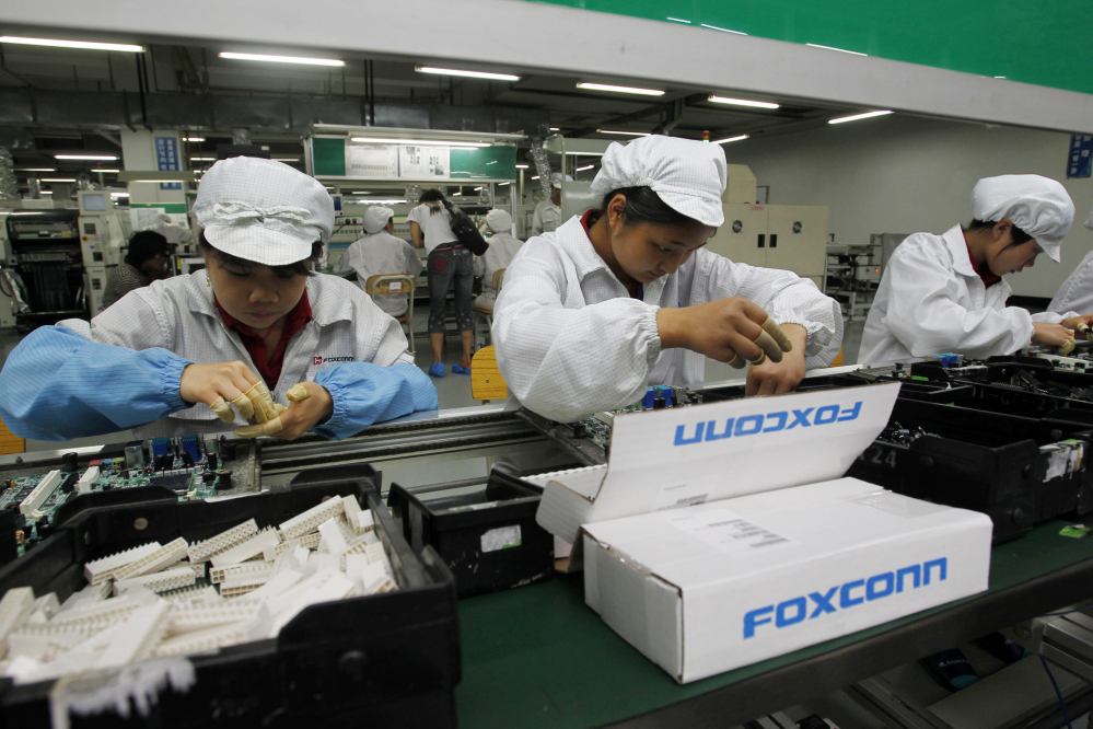 Foxconn staff on the production line at its complex in the Chinese city of Shenzhen. Foxconn said its $10 billion Wisconsin factory will eventually employ 13,000 workers.