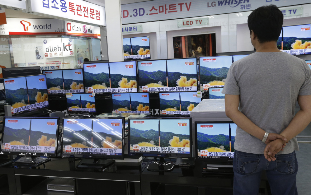 A man watches TV screens in an electronics shop showing a news program's report on North Korea's missile firing in Seoul, South Korea, this month. North Korea fired a ballistic missile Friday night, which landed in the ocean off Japan, Japanese officials said.