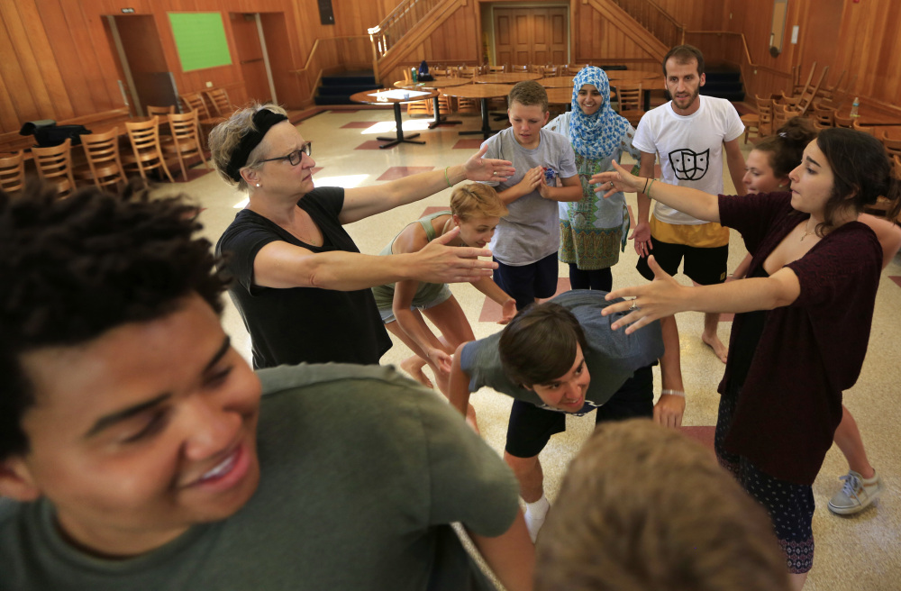 In this Wednesday, July 26, 2017, photo, participants role-play in a drama therapy workshop at Project Common Bond, a summer camp being held at Colby College in Waterville, Maine. The project seeks to create a new generation of socially conscious adults by bringing together young people impacted by violent trauma.