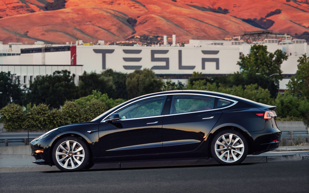 This undated image provided by Tesla Motors shows the Tesla Model 3 sedan. The electric car company's newest vehicle, the Model 3, which was going to its first 30 customers late Friday, is half the cost of previous models. Its $35,000 starting price and 215-mile range could bring hundreds of thousands of customers into Tesla's fold, taking it from a niche luxury brand to the mainstream.