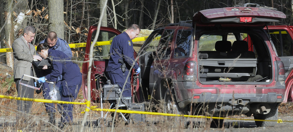 Maine State Police evidence technicians examine the SUV containing two bodies discovered early on Dec. 25, 2015, on Sanford Road in Manchester. The bodies were those of Eric Williams and Bonnie Royer, who lived nearby in Augusta, and who were shot to death. David Marble Jr. is charged in connection with the slayings.