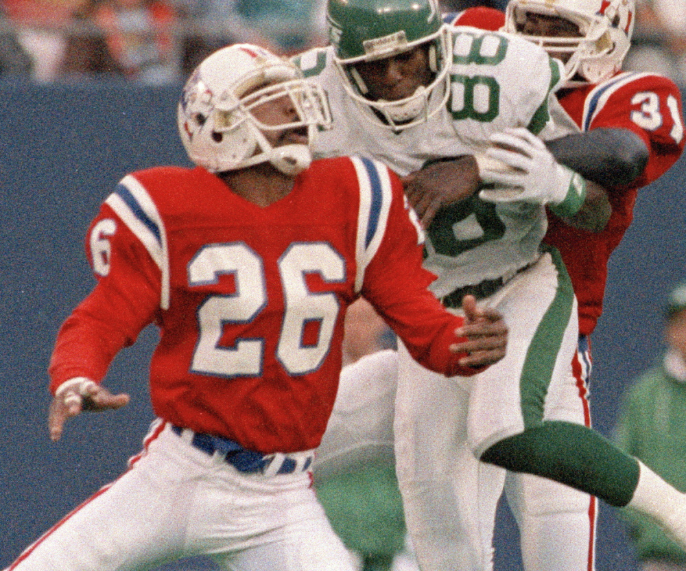 Raymond Clayborn, left, and Fred Marion of the Patriots put a hit on Jets receiver Al Toon on Nov. 14, 1988. Clayborn was inducted Saturday into the team's Hall of Fame.