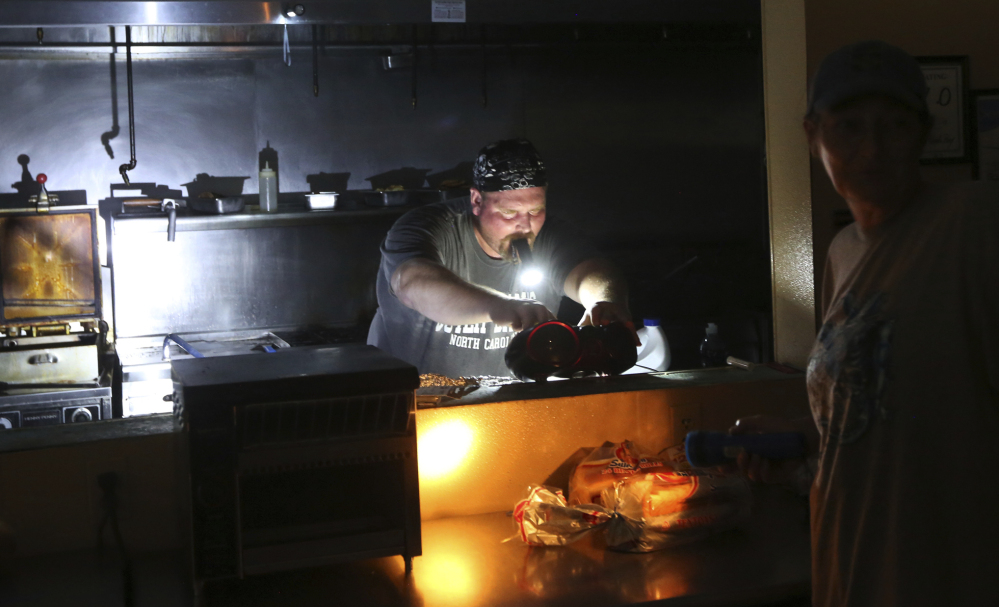 Aaron Howe is forced to cook in the dark kitchen at his store.