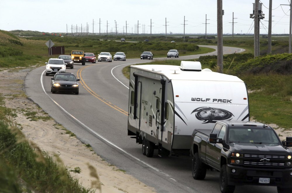 Vacationers depart Hatteras Island on Friday after a power outage caused by a construction crew accidentally driving a steel casing into an underground transmission line.