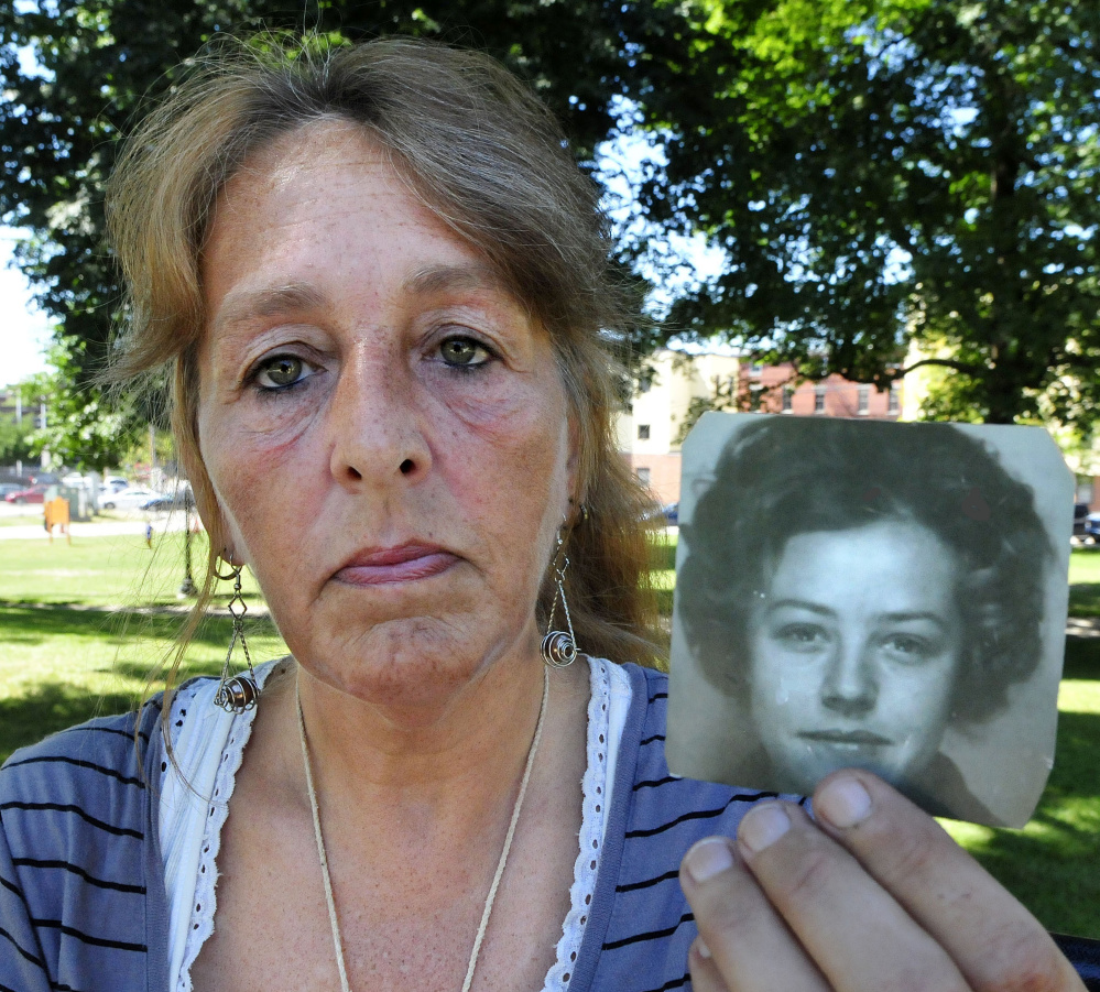 Honey Rourke, 53, of Lewiston holds a photograph of her mother, Pauline Rourke, taken in 1970. Honey was just 12 when her mother disappeared in 1976. Albert P. Cochran, 79, a convicted murderer who told police he knew the location of Pauline Rourke's remains, died last month in a Rockport hospital while serving a life sentence.