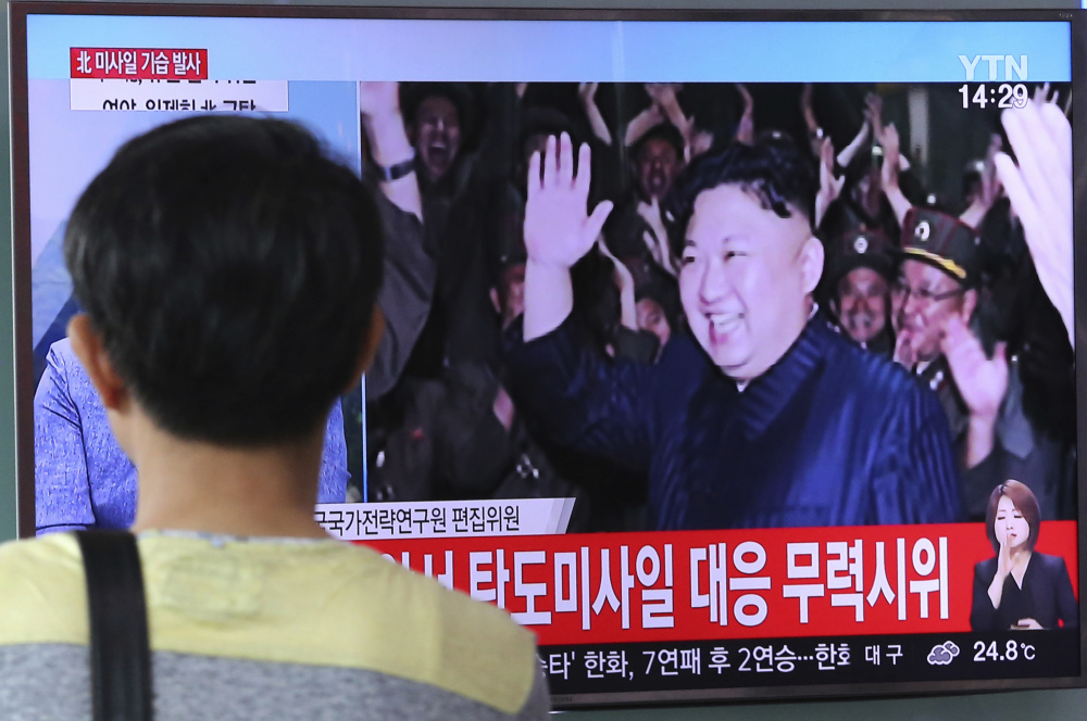 North Korean leader Kim Jong Un appears on TV in Seoul, South Korea, during the latest missile test launch.