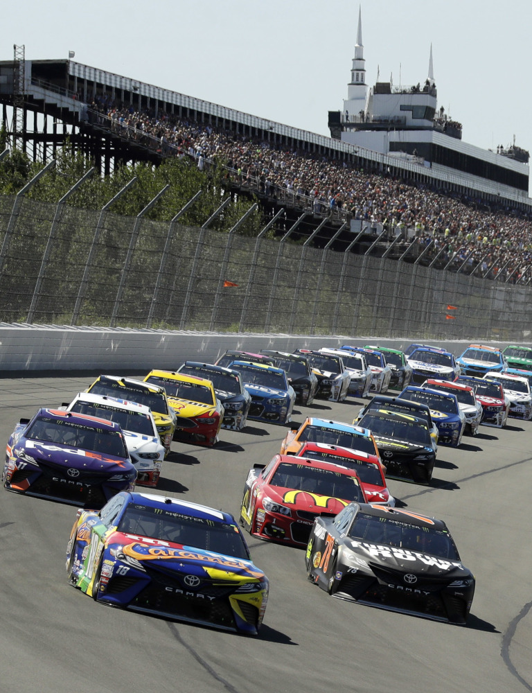 Kyle Busch (18) leads the field into Turn 1 at the start of the Cup Series race Sunday at Pocono Raceway.