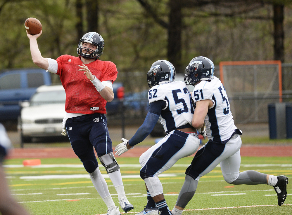 UMaine quarterback Max Staver throws a pass during the team's spring scrimmage May 6. Staver, a senior transfer, is competing for the starting job.
