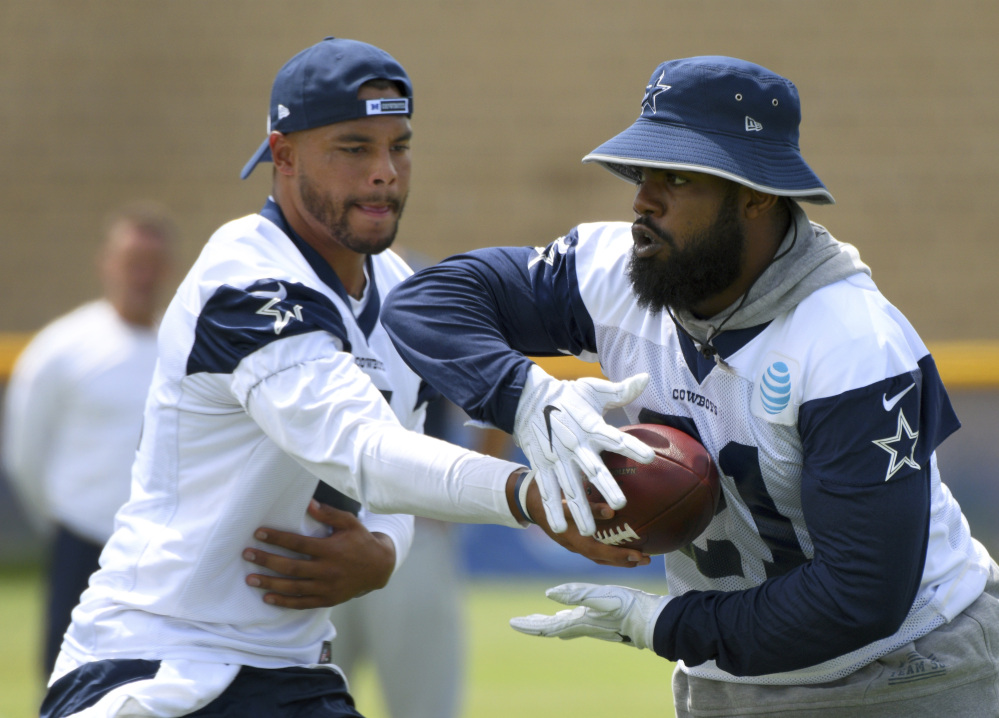 Quarterback Dak Prescott, left, and running back Ezekiel Elliott helped the Cowboys thrive during their rookie season in Dallas. The duo is seen as the key to Dallas contending for a Super Bowl, but Elliott could be suspended to start the season.