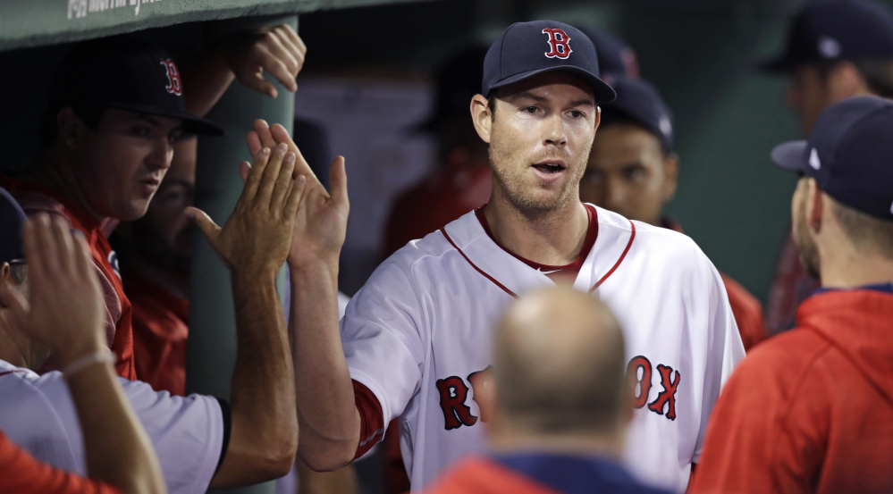 Red Sox starter Doug Fister is congratulated by teammates after being pulled in the eighth inning. Fister got his first win of the season, giving up just two runs on five hits.