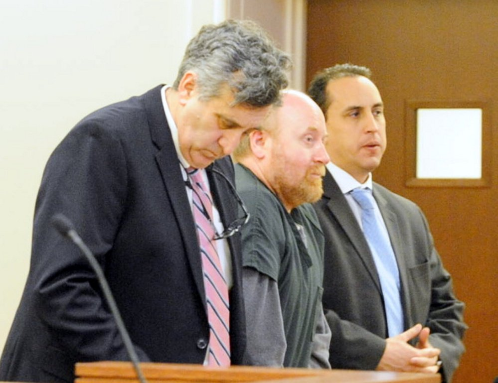 Attorneys Ronald Bourget, left, and Darrick Banda, right, stand with Roland Cummings during sentencing Jan. 21, 2016, at the Capital Judicial Center in Augusta. He was sentenced to life without parole for murder of Aurele Fecteau.