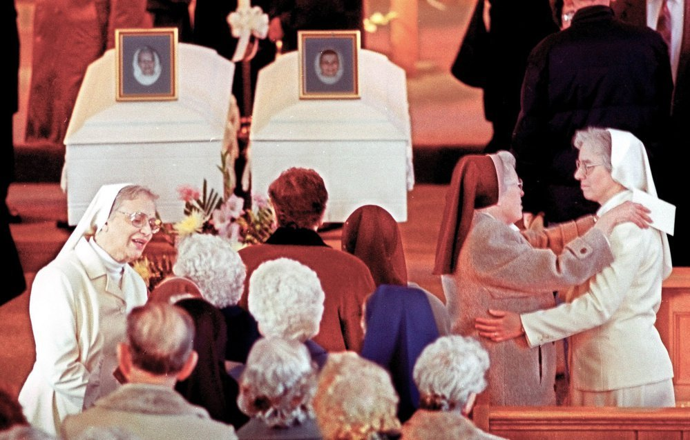 Superior General Sister Mary Catherine Perko, left, and Provincial Superior Sister Catherine Marie Caron greet mourners on Jan. 31, 1996, at the wake held for slain Sister Edna Mary Cardozo, in the left casket, and Sister Marie Julien Fortin. Mark A. Bechard, who killed the two women, died Sunday at a long-term care facility in Freeport.