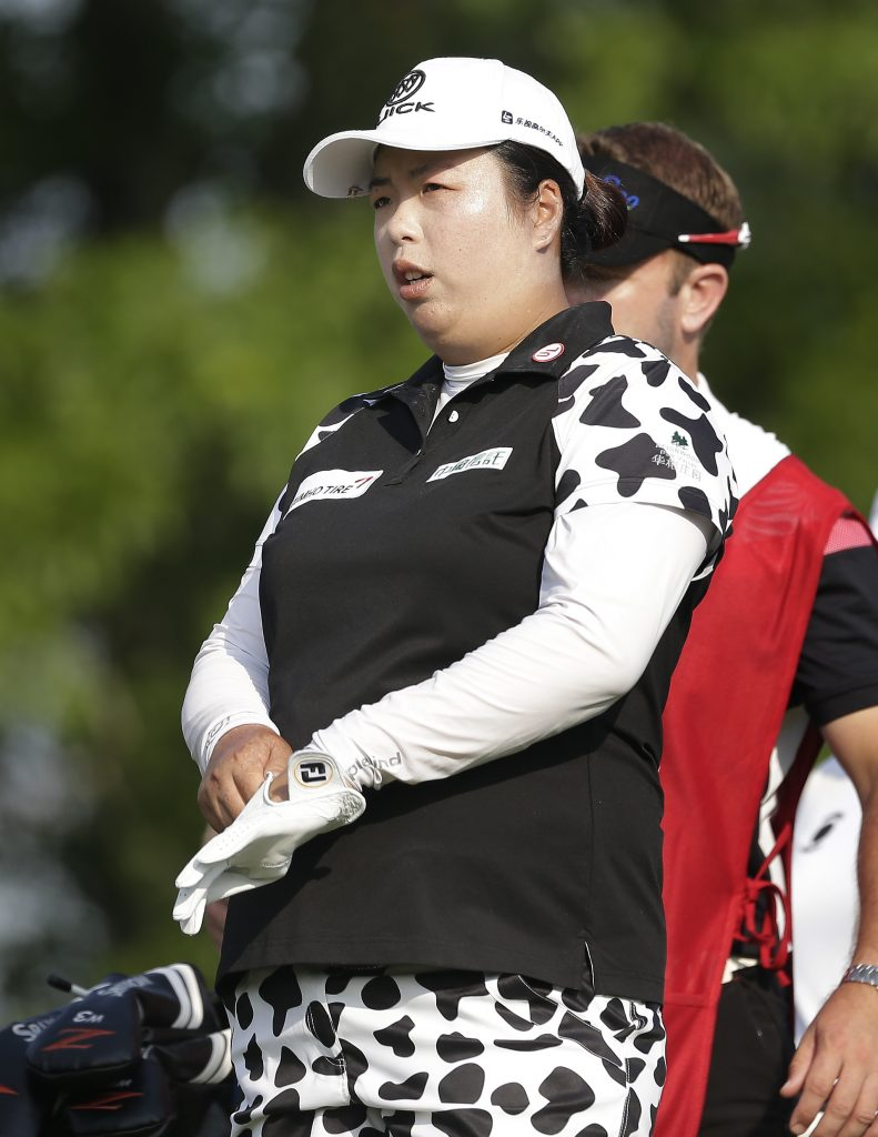 Shanshan Feng lines up her shot on the 13th tee during the first round of the U.S. Women's Open Golf tournament Thursday in Bedminster, N.J.