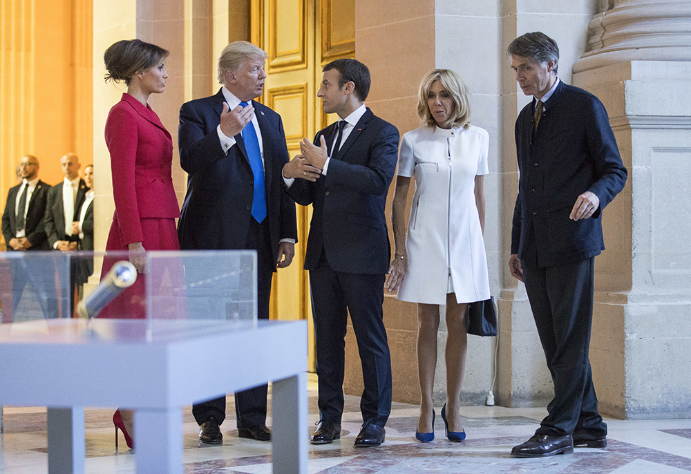 President Trump, Melania Trump, French President Emmanuel Macron and his wife Brigitte Macron tour Marechal Foch's Tomb with David Guillet, director of the Army Museum, at Les Invalides in Paris on Thursday.