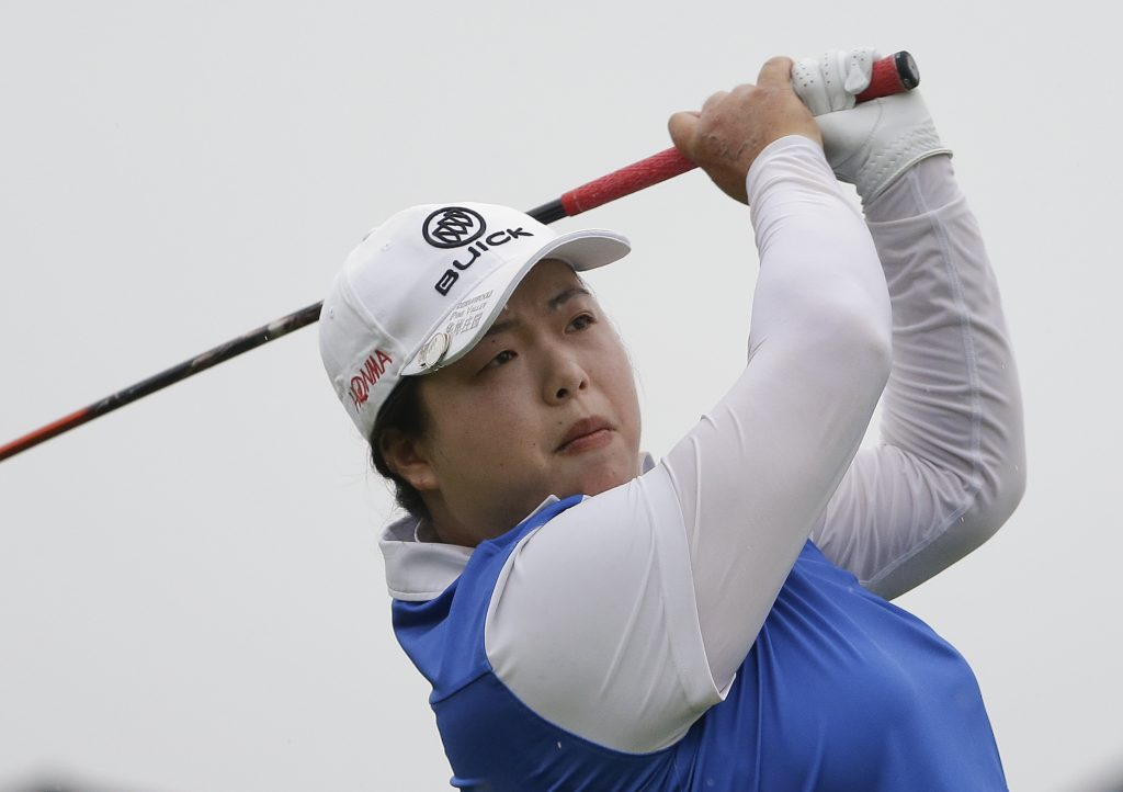 Shanshan Feng tees off on the second hole during the second round of the U.S. Women's Open Golf tournament Friday in Bedminster, N.J.