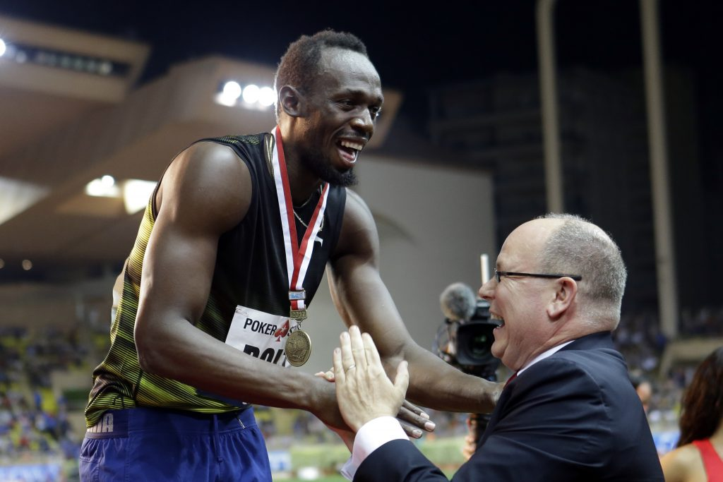 Jamaica's Usain Bolt shares a laugh with Prince Albert of Monaco during the podium ceremony after winning the men's 100 at the IAAF Diamond League Athletics meeting at the Louis II Stadium in Monaco, Friday.
