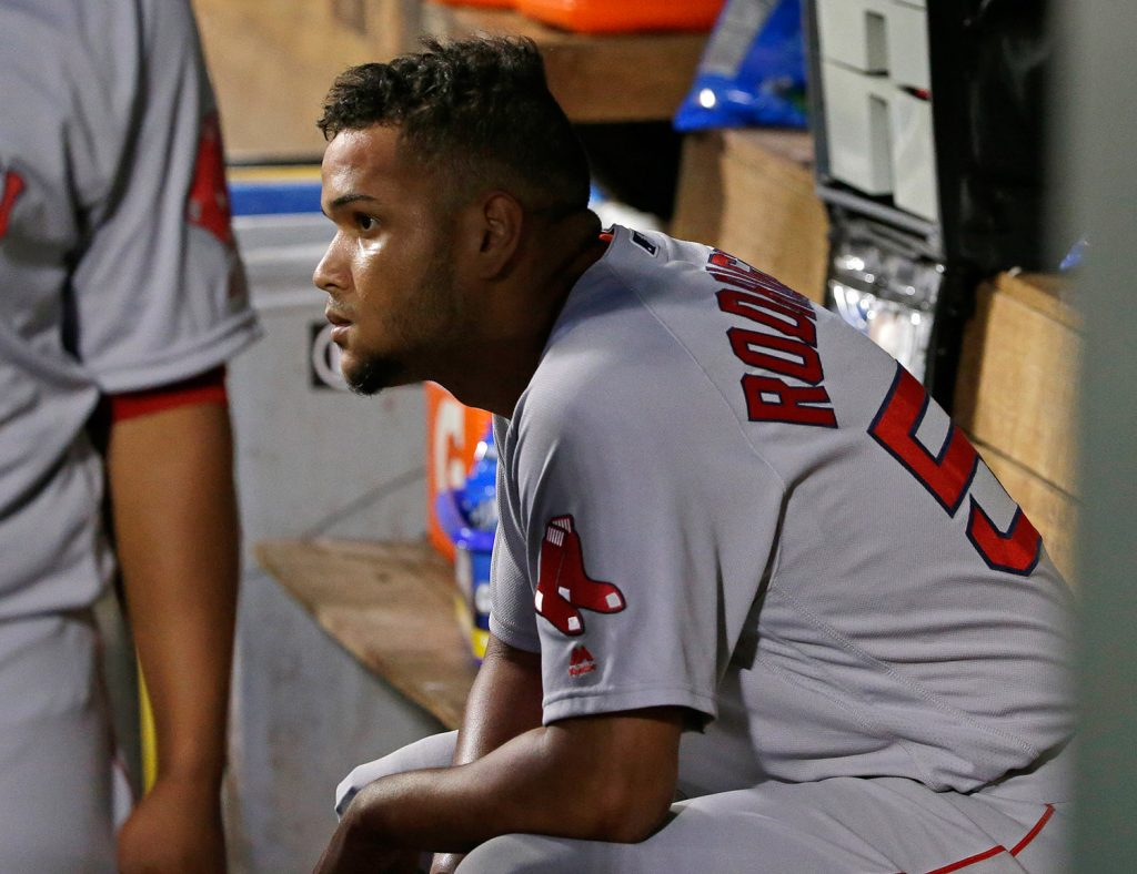 Boston starting pitcher Eduardo Rodriguez sits in the dugout after he was pulled in the sixth inning in Seattle.
