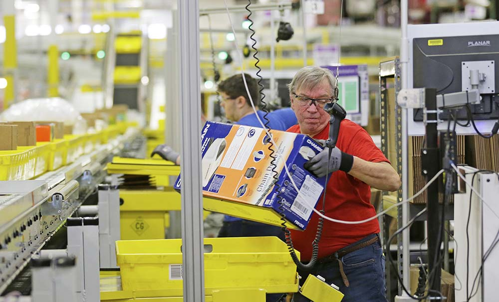 An Amazon employee processes orders at the company's fulfillment center in DuPont, Wash. Its Jobs Day on Aug. 2 will give potential employees a chance to see what it's like to work at one of 10 fulfillment centers nationwide.