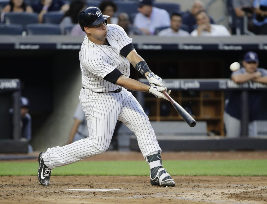 Gary Sanchez of the Yankees hits a solo home run in the third inning against Tampa Bay Thursday night in New York.