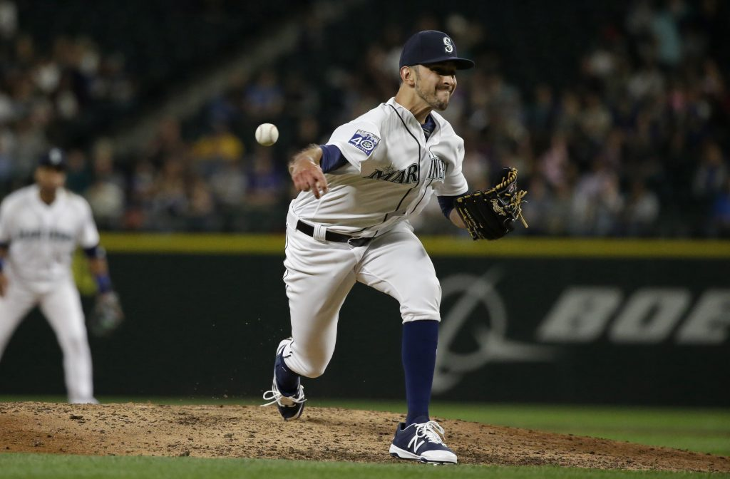 Steve Cishek was traded from Seattle to the Tampa Bay Rays on Friday for versatile right-hander Erasmo Ramirez.