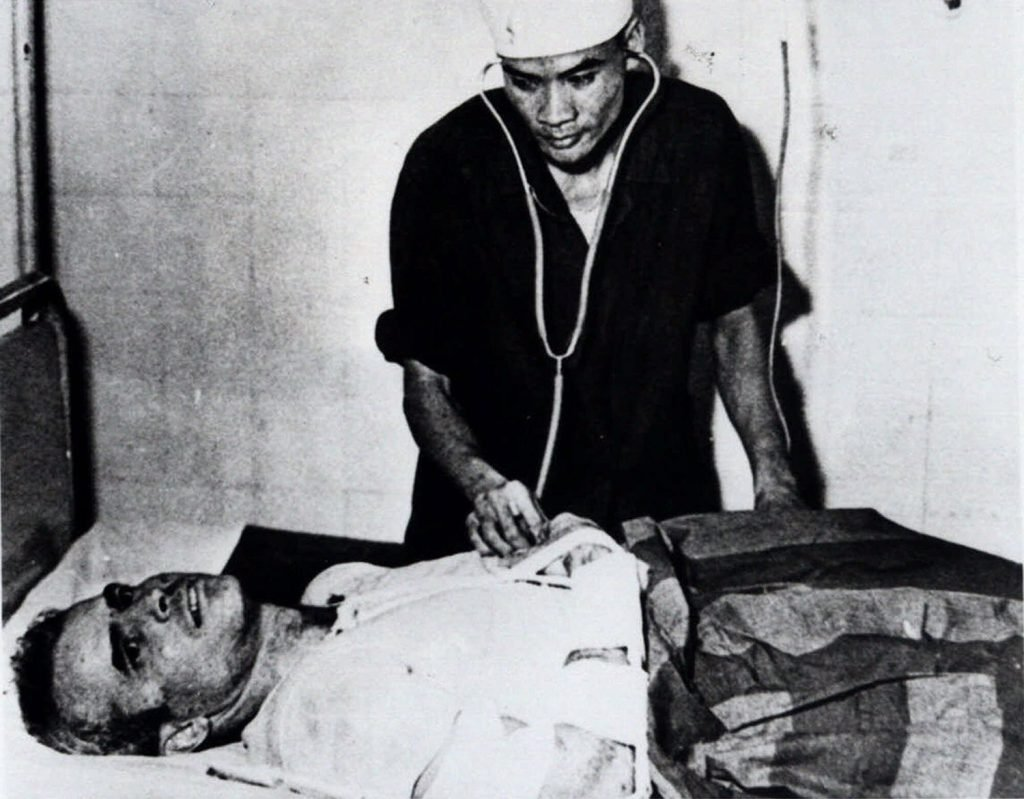 John McCain is administered to in a Hanoi, Vietnam, hospital as a prisoner of war in the fall of 1967. McCain spent 20 years in the Navy, a quarter of it in a Vietnamese prisoner of war camp after his jet was shot down over Hanoi during a bombing mission on Oct. 26, 1967.
