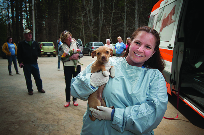 Dr. Mandie Wehr, veterinarian and shelter director for the merged Coastal Humane Society and Lincoln County Animal Shelter, carries Zola during a rescue operation.