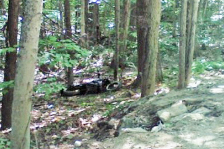 This photo furnished by the York County Sheriff's Department shows the  motorcycle crash site off Hopper Road in Acton.
