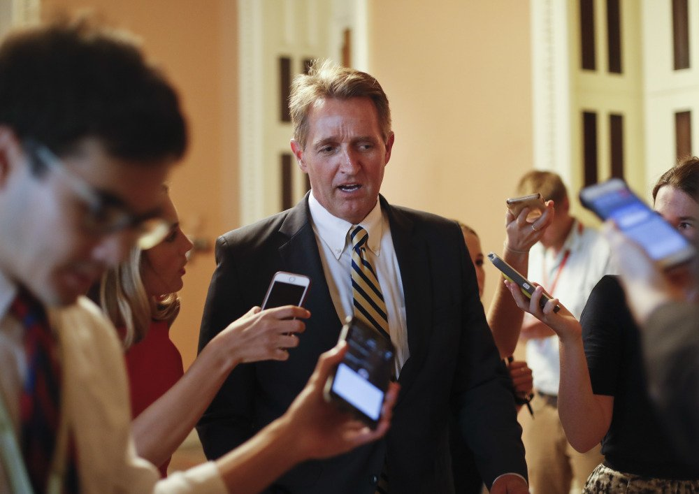 "Sen. Jeff Flake, R-Ariz., takes aim at Trump and his own party in a new book, writing that ""Unnerving silence in the face of an erratic executive branch is an abdication"" and ""The strange specter of an American president's seeming affection for strongmen and authoritarians created such a cognitive dissonance among my generation of conservatives – who had come of age under existential threat from the Soviet Union – that it was almost impossible to believe."""