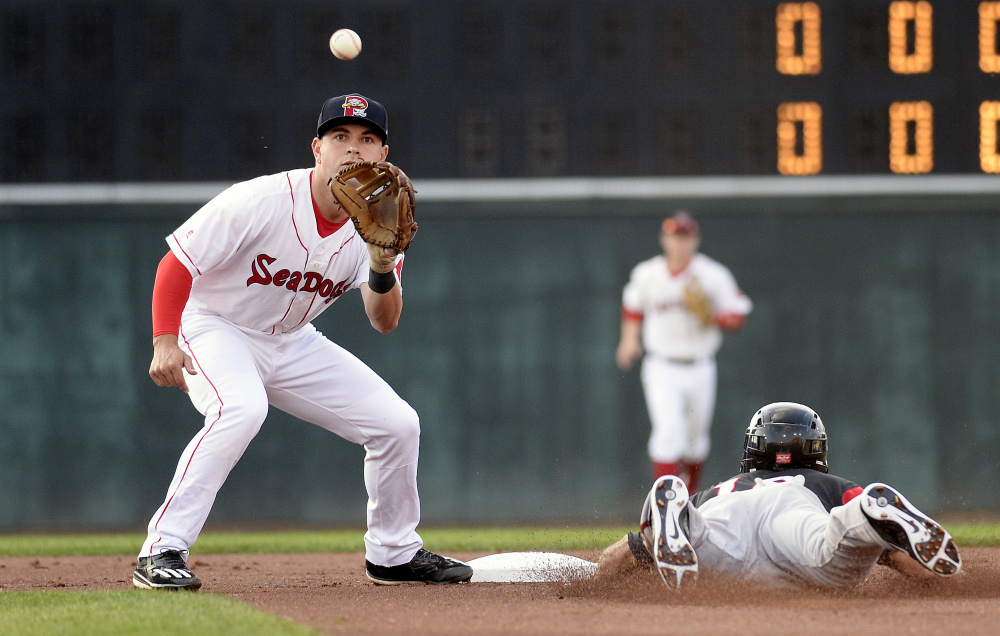 Portland's Chad De La Guerra waits for the throw as T.J. Bennett of the Richmond Flying Squirrels safely slides into second Tuesday at Hadlock Field.