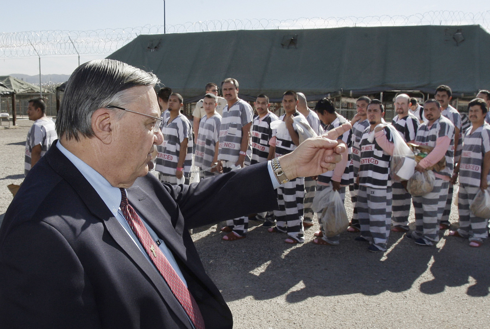 In this Feb. 4, 2009 file photo, then-Maricopa County, Ariz., Sheriff Joe Arpaio orders approximately 200 convicted illegal immigrants handcuffed together in Tent City in Phoenix for incarceration until their sentences are served and they are deported to their home countries. Associated Press/Ross D. Franklin