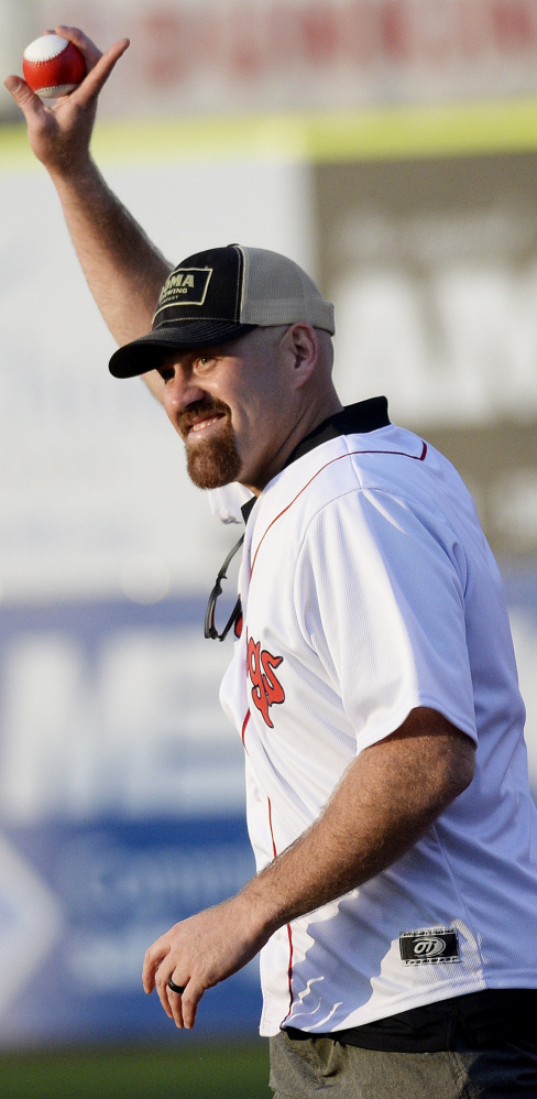 Kevin Youkilis, the former Portland Sea Dog who won two World Series with the Red Sox, acknowledges the crowd Tuesday night while throwing out the first pitch at Hadlock Field.