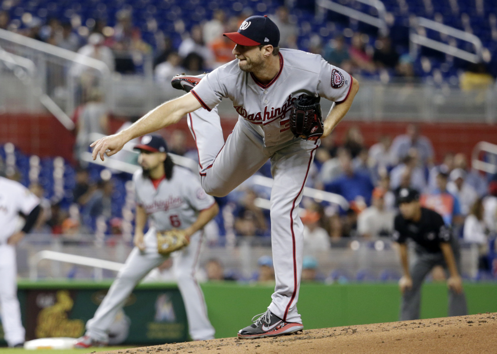 ffe929b418f Max Scherzer of the Washington Nationals follows through on a delivery in  the first inning Tuesday