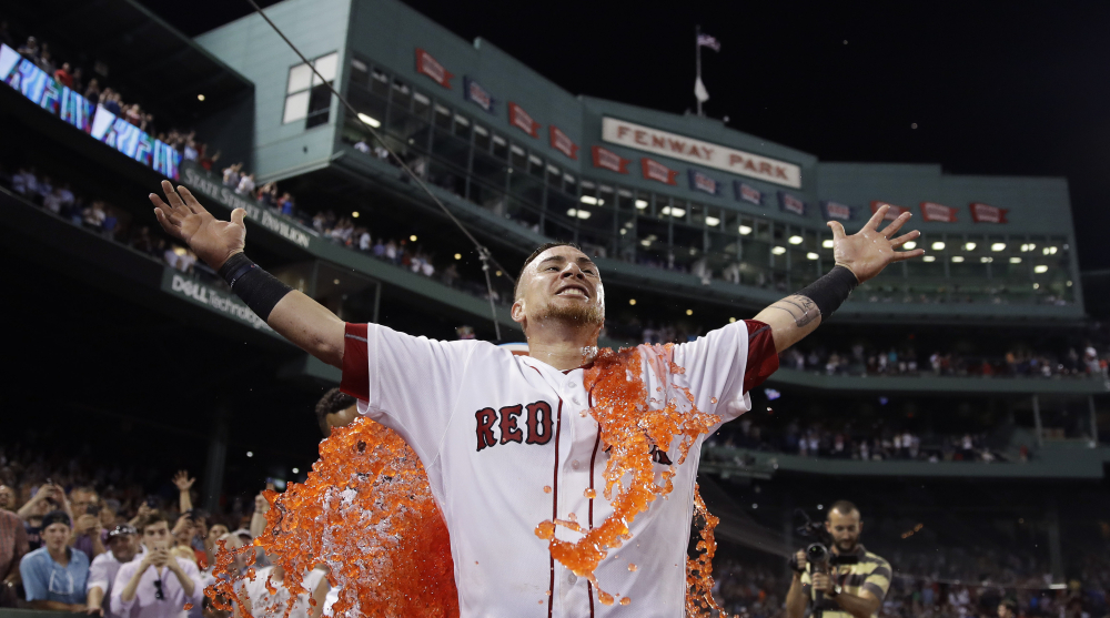 The Red Sox's Christian Vazquez is doused after his three-run homer in the bottom of the ninth against the Cleveland Indians on Tuesday at Fenway Park.