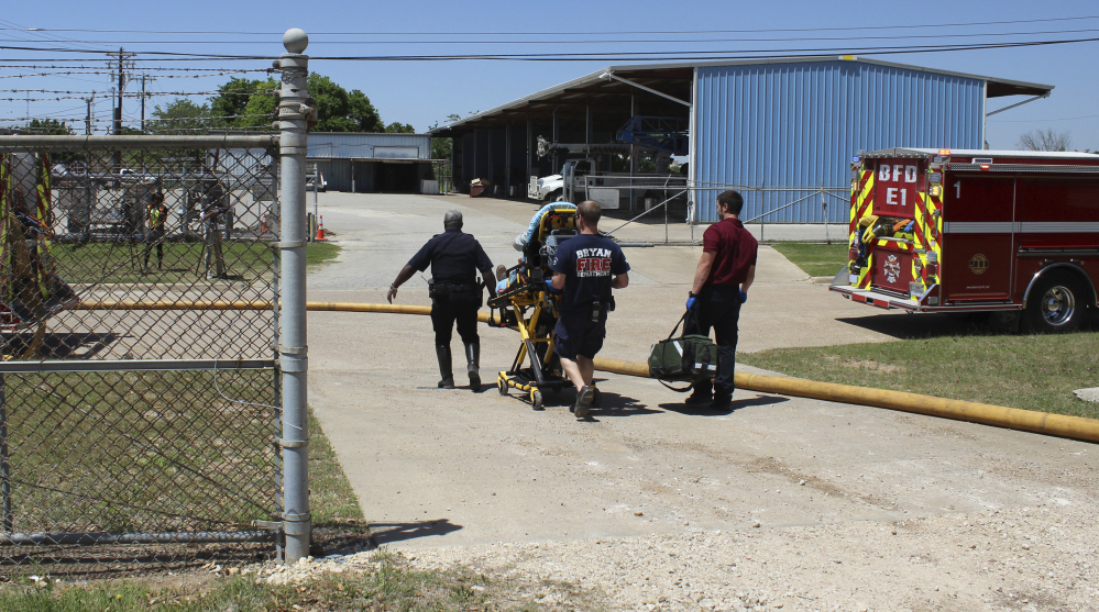 Firefighters transport a victim to an ambulance after an explosion at the Bryan Texas Utilities Power Plant that killed Earle Robinson, 60, and injured two other employees in 2014. That year, the fatality rate among older workers in Texas was 6.1 per 100,000 workers – 43 percent higher than the accident rate for all workers.