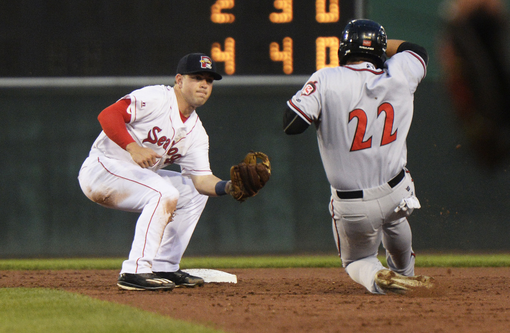 Portland's Chad De La Guerra tags out Richmond's Dylan Davis on a double play Wednesday at Hadlock Field in Portland. Richmond went on to a 7-5 win in 11 innings.