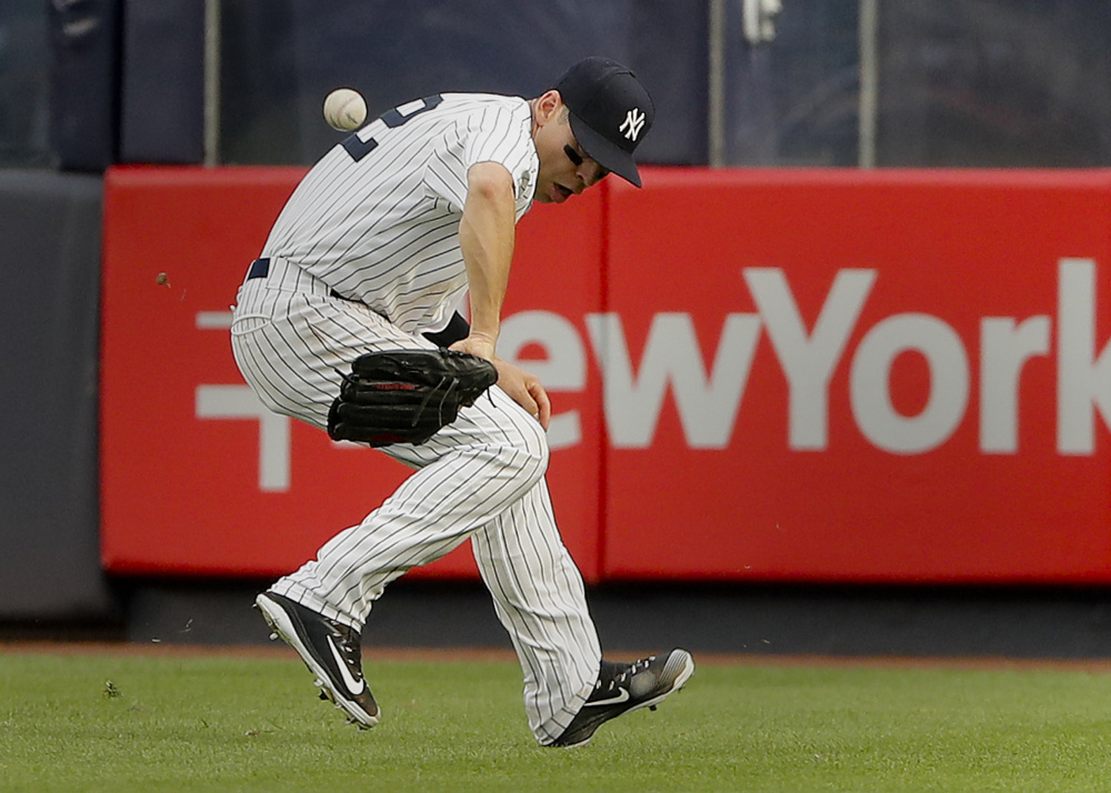 Yankees center fielder Jacoby Ellsbury mishandles a hit by Detroit's James McCann during the fourth inning Wednesday. Ellsbury was charged with an error on the play.