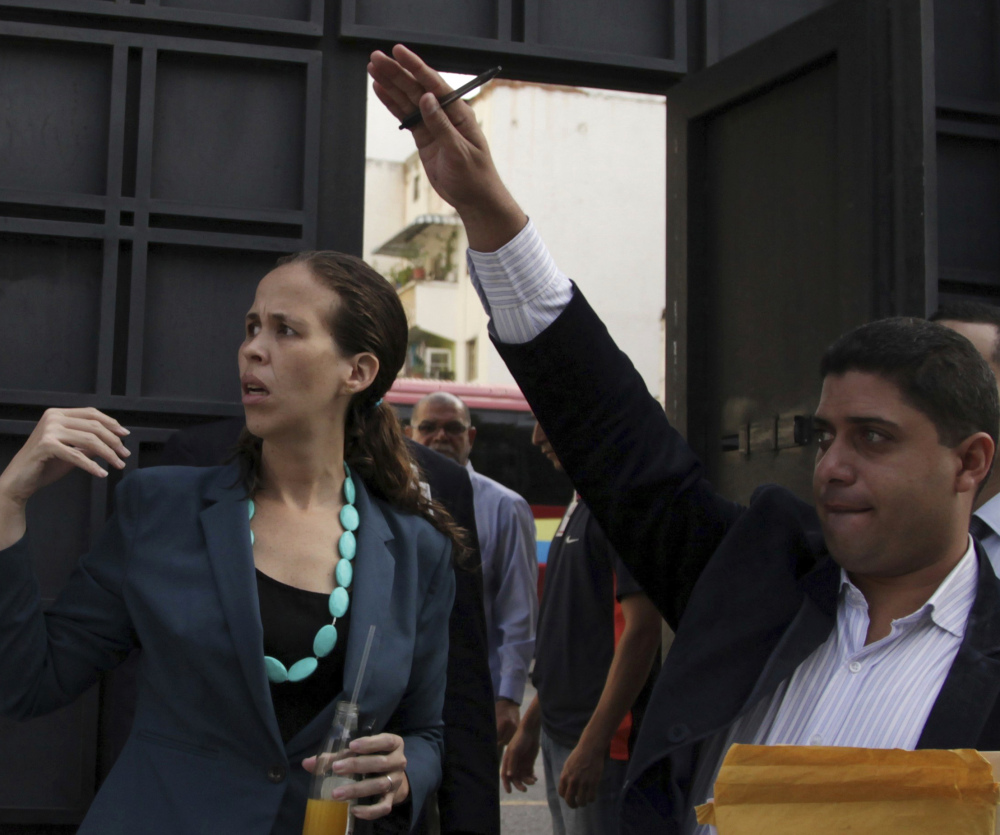 Opposition lawmaker Manuela Bolivar, left, at the Venezuelan General Prosecutor's office Thursday to push for an investigation into the recent elections.