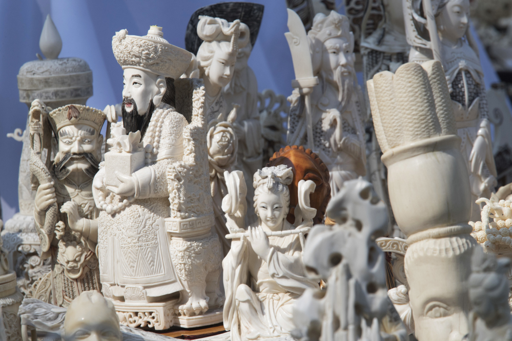 Ivory sculptures are on display before being crushed Thursday in New York's Central Park. Nearly 2 tons of ivory was destroyed to protest slaughter of elephants.