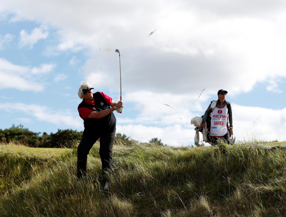Laura Davies plays out of the rough Thursday during the first round of the Women's British Open at St. Andrews, Scotland. Weather was a factor for Davies, who started 6-under after 14 holes and finished at 68.