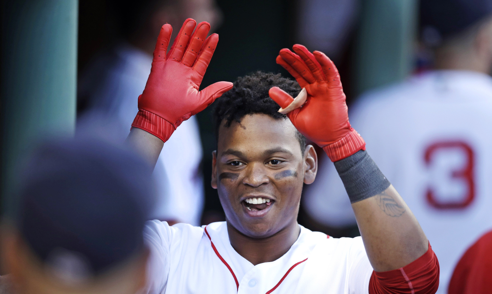 Rafael Devers celebrates his two-run home run off Chicago White Sox starting pitcher Miguel Gonzalez in the first inning Thursday night at Fenway Park.