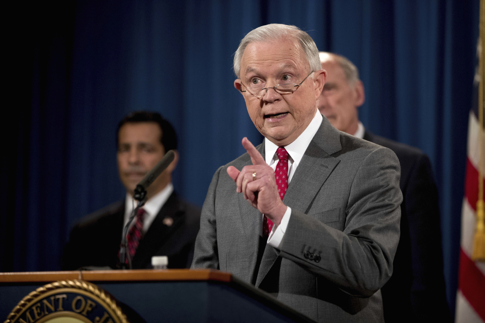 Attorney General Jeff Sessions, accompanied by, from left, National Counterintelligence and Security Center Director William Evanina and Director of National Intelligence Dan Coats, speaks at the Justice Department on Friday about a crackdown on leaks of government information.