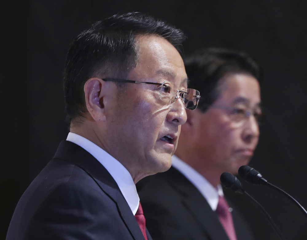 Toyota Motor Corp. President Akio Toyoda, left, and Mazda Motor Corp. President Masamichi Kogai hope to rein in competition from industry newcomers like Amazon, Google and Apple.